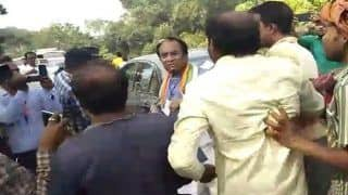 West Bengal Bypolls 2019: BJP State Vice President Thrashed Allegedly by TMC Activists | Watch