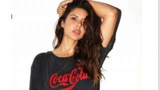 Punjabi Actor Sonam Bajwa Oozes Oomph as She Sensuously Poses in a Basic T-shirt And Brief