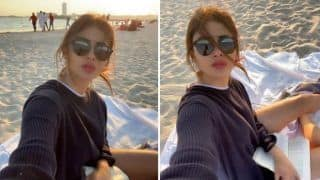 Mouni Roy Shares Sultry Picture in Black Pull-over as She Relaxes by The Beachside