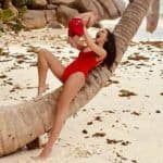 Amy Jackson Shares Sizzling Hot Picture in Red Monokini While Holding Her Son Andreas on Sandy Beach