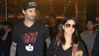 Sunny Leone's Husband Daniel Weber Cannot Get His Eyes Off Her as They Walk Hand-in-hand at Mumbai Airport
