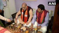 चुनावी सभाओं के बाद अचानाक भाजपा कार्यकर्ता के घर पहुंचे अमित शाह, किया भोजन