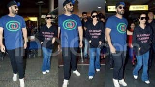 Arjun Kapoor Protects Malaika Arora at Airport as They Return From New Year Holiday - Viral Video