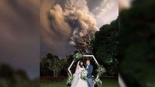 Crazy in Love? Couple Continue With Wedding Despite A Volcano Erupting in the Background in Philippines