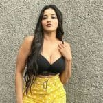 Bhojpuri Actor Monalisa Oozes Hotness in Black Bralette Top And Yellow Shorts