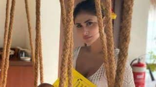 Mouni Roy Goes Sultry in Sheer White Little Dress as She Indulges Herself in Reading