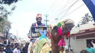 Kerala Groom Arrives On Camel Holding Anti-CAA Poster, Gifts Constitution To Bride