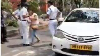 Bizarre! Kolkata Woman Licks A Cop For Stopping Her On The Streets Amid Coronavirus Lockdown | Watch