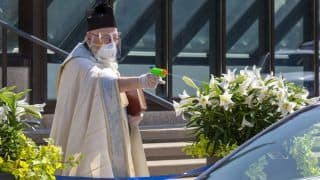US Priest Sprays Holy Water From Toy Gun To Maintain Social Distancing, Inspires Memes Online