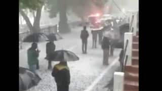 Trending News Today May 6, 2020: With Masks & Umbrellas, People in Nainital Brave Rain & Hailstorm to Buy Alcohol   Watch Viral Video