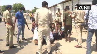 प्रवासी मजदूरों ने पुलिसकर्मियों पर किया पथराव, 2 घायल, कई वाहन क्षतिग्रस्त
