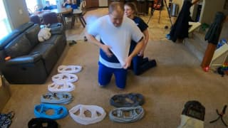Woman Dresses Husband in 32 T-Shirts in One Minute to Break Guinness World Record | Watch the Crazy Video