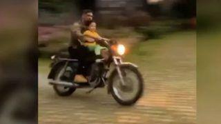 WATCH: आसमान में कड़कती बिजली के बीच धोनी ने निकाली बाइक, बेटी जीवा को कराई सैर
