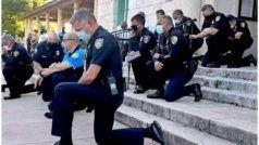 अमेरिका हिंसा: प्रदर्शनकारियों के सामने घुटनों पर बैठी पुलिस, रोने लगे लोग, हिंसा रोक मिले गले