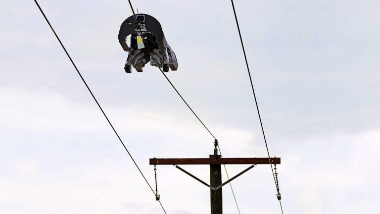 This Facebook Robot Walks on Power Lines to Install Fibre-Optic Cable