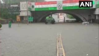 Delhi Rains: DTC Bus Gets Stuck in Waterlogged Road, Fire Services Personnel Rescue Passengers | Watch