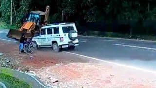 Such a Miracle! Narrow Escape For Biker As Bolero Rams into Speeding JCB | Watch Jaw-Dropping Video