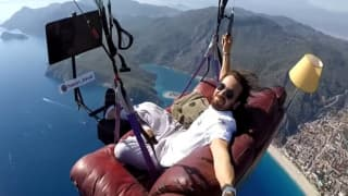 Bizarre Adventure! Turkish Man Paraglides On His Sofa While Watching TV & Eating Chips Mid-Air | Watch Video