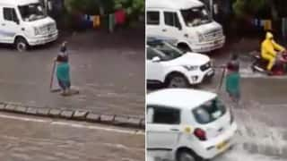 Mumbai Woman Stands in Rain For 5 Hours to Warn Commuters of Open Manhole | Watch