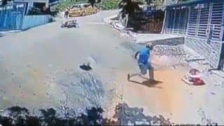 Man Jumps Off Bike to Save Toddler From Rolling Down Steep Road, Video Goes Viral