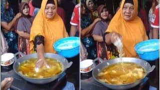 Watch: 'Badass' Woman Puts Her Bare Hand in Boiling Oil to Fry Food, Video Baffles Netizens