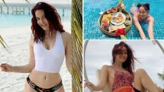 'Beach Bum' Elli AvrRam Flaunts Flawless Body in a White Crop Top and Printed Bikini Bottoms While Reminiscing Memories from Maldives