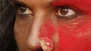 न्यूड फोटो के बाद आंखों में काजल, आधे चेहरे पर गुलाल, नाक में नथ डाले मिलिंद सोमन ने क्यों बना लिया ऐसा हाल?