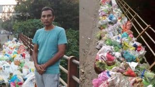 Man Stands Whole Day Beside Godavari River to Stop People From Dumping Garbage Bags