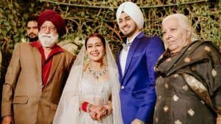 Neha Kakkar-Rohanpreet Singh's New Pics From Wedding Reception: Bride And Groom Cut The Giant Cake, Pose With Family Members