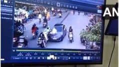 VIDEO: नियम तोड़ने पर गाड़ी रोकी तो ट्रैफिक पुलिस को कार के बोनट पर घसीटा, CCTV में कैद हुई घटना