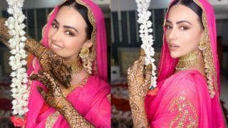 Sana Khan Shares Pictures From Her Mehendi Ceremony, Looks Fabulous in Orange-Pink Suit