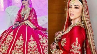 Sana Khan As A New Bride Looks Drop Dead Gorgeous In A Red and Golden Lehenga By Poonams Kaurture, See PICS