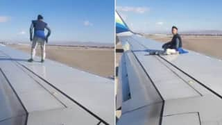 Crazy! Man Climbs Onto Airplane's Wing Right Before Takeoff at Las Vegas Airport | Watch Video
