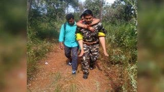 Andhra Constable Carries Elderly Devotees on His Back After They Faint During Tirupati Trek