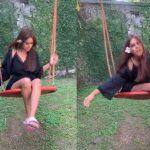 Nia Sharma Enjoys Her Sunday Afternoon While Swinging in a Black Satin Plunging Neckline Dress- Watch