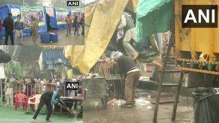 दिल्ली की सीमाओं पर डटे किसानों की बारिश ने बढ़ाई मुश्किलें, तंबुओं में भरा पानी; ईंधन की लकड़ी और कंबल भी भीगे