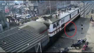 Motorcycle Crushed Into Pieces by Speeding Train, Biker Has a Narrow Escape | Watch Jaw-Dropping Video