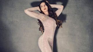 Nora Fatehi Shows Off Her Curvacious Body in a Sexy Figure-Hugging Gown