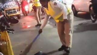 Woman Police Constable Sweeps Road to Remove Broken Glass pieces, Video Goes Viral