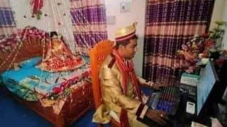 Gone Viral: This Photo of Groom Sitting at Computer on Wedding Night While Bride Waits For Him!