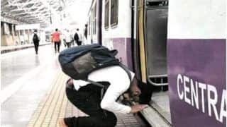 Man Bows Down Before Boarding Mumbai Local Train As Services Resume, Moving Image Goes Viral
