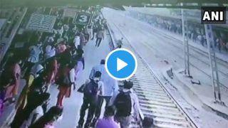 Video: Train को आता देख शख्स ने सुसाइड करने के लिए रेलवे ट्रैक पर चादर बिछाकर लेट गया, तभी RPF जवान ने बचा ली जान