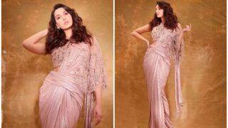 कैमरे के सामने नोरा फतेही ने बदल लिए कपड़े, शिमर ड्रेस में दिखाया अपना हॉट अंदाज- VIDEO वायरल
