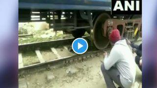 VIDEO: चलती TRAIN के नीचे फंसी नजर आई महिला, देखें आगे क्या हुआ?