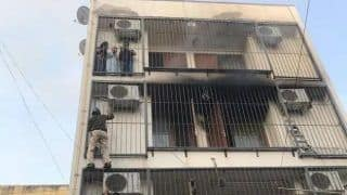 Photo Shows Hero Delhi Cop Climb 3-Storey Building Caught in Fire to Save Family
