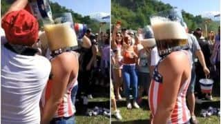 Drink or Drown? Man Gulps Down Entire Bucket of Beer in Just a Few Seconds | Watch Viral Video