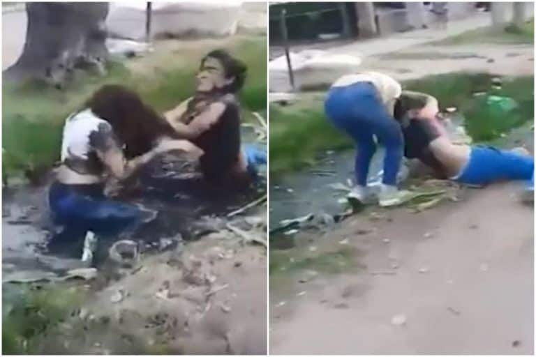 Viral Video: 2 Girls Fight Violently in Middle of The Road, Push Each Other Into Dirty Drain | Watch