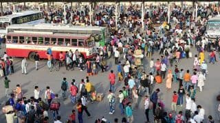 Migrants Rush Home as Delhi Enters Lockdown, Massive Crowds at Bus Stands | See Visuals