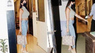 Nora Fatehi Pairs Rs 2.5 Lakh Bag With Chic Crop Top And Denim| View Photos