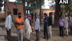 UP Gram Panchayat Election 2021 Phase 1 Voting Live: Voters Break COVID Guidelines at Polling Booth in Agra